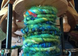 art yarn on bobbin blue green