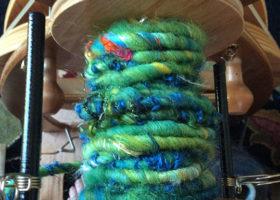 art yarn on bobbin blue green